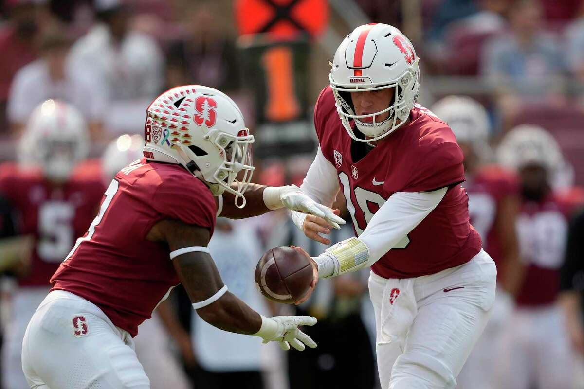 Stanford quarterback Tanner McKee (18) hands off to running back Nathaniel Peat (8) during the first half against UCLA. Peat leads the Cardinal with 196 yards rushing, averaging 7.3 per carry.