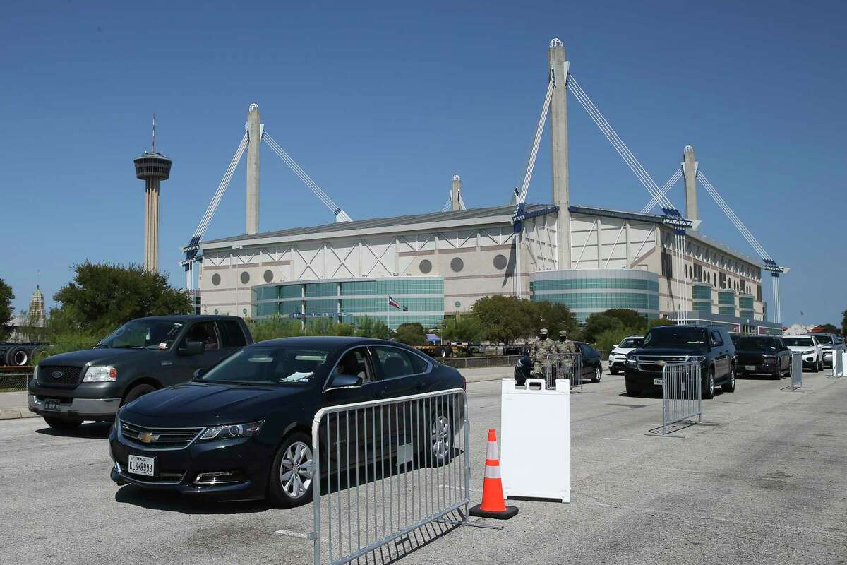 Vehicles line up at a drive-through COVID-19 Pfizer booster shot clinic at the Alamodome on Wednesday, Sept. 29, 2021. The clinic, opened by the San Antonio Metropolitan Health District, will operate Wednesdays through Fridays from noon to 8 p.m.