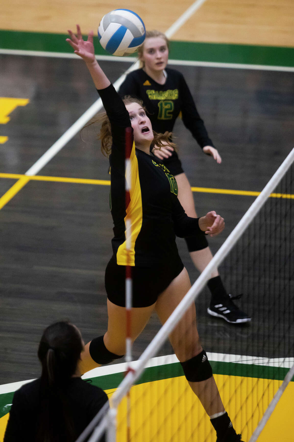 Dow's Jessica Erickson spikes the ball during the Chargers' match against Flint Powers Thursday, Sept. 30, 2021 at H. H. Dow High School. (Katy Kildee/kkildee@mdn.net)