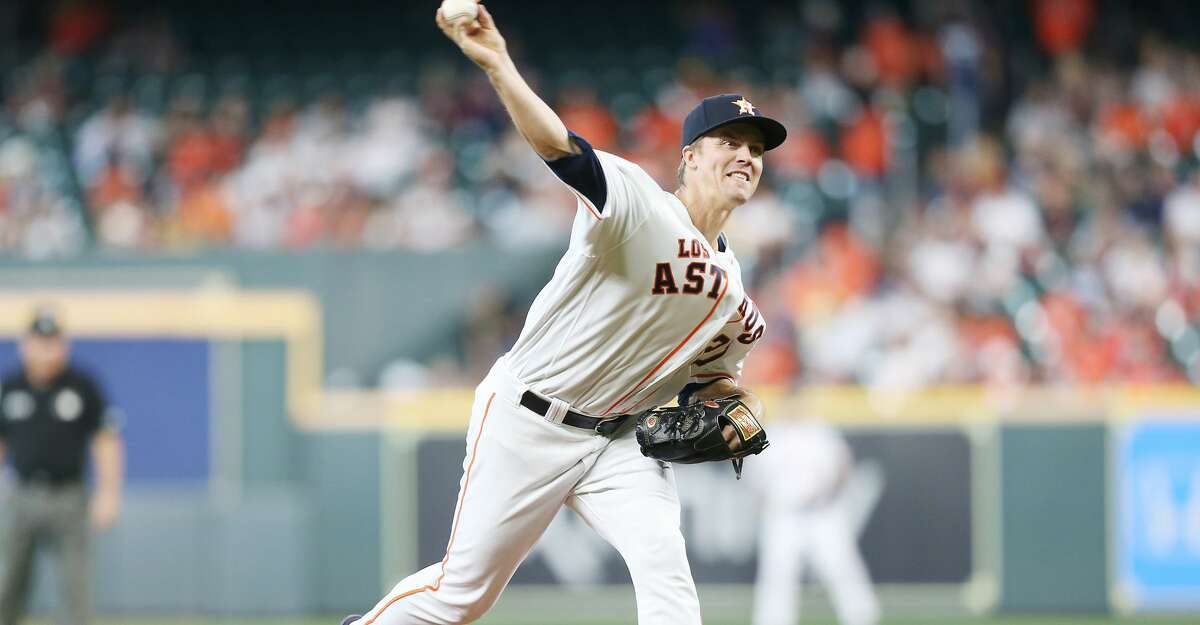 Houston Astros starting pitcher Zack Greinke (21) pitches in the third inning against the Arizona Diamondbacks at Minute Maid Park in Houston on Sunday, Sept. 19, 2021.