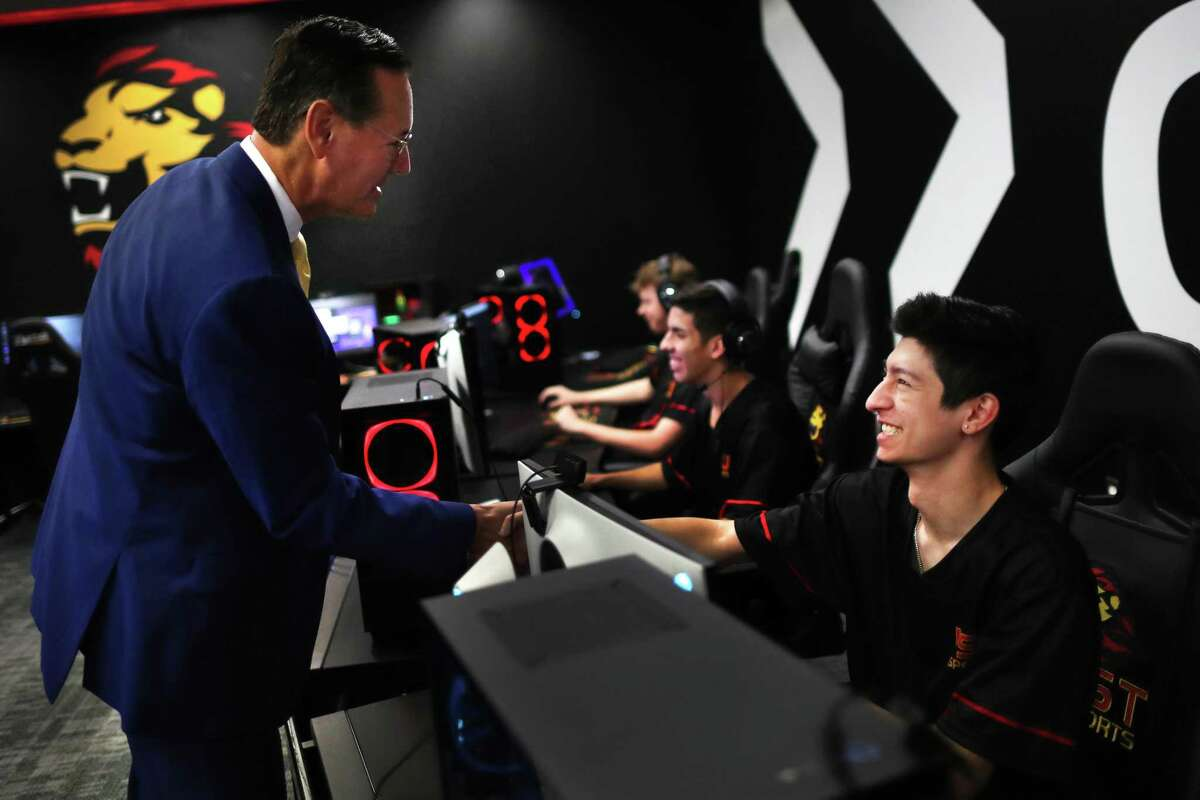 University of St. Thomas president Richard Ludwick meets Daniel Ibrahim, 21, a member of the university's e-sports team during the inauguration of the new E-Sports Gaming Room, Tuesday, Aug. 31, 2021, in Houston.