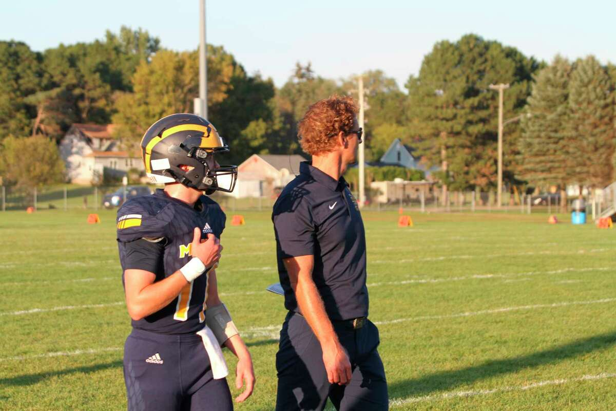 Manistee head coach Troy Bytwork and quarterback Jeff Huber prepare to take on Mason County Central. (McLain Moberg/News Advocate)