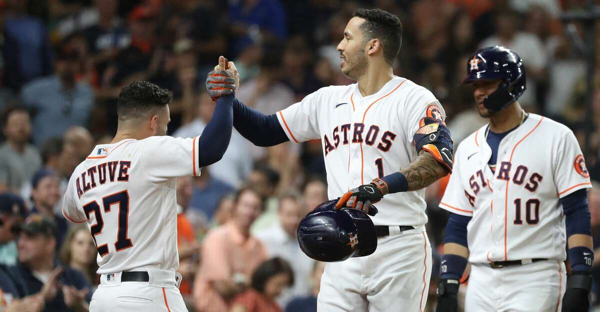 Houston Astros Carlos Correa (1) celebrates his home run with Jose Altuve off of Tampa Bay Rays relief pitcher Ryan Yarbrough (48) during the fourth inning of an MLB baseball game at Minute Maid Park, Thursday, September 30, 2021, in Houston.