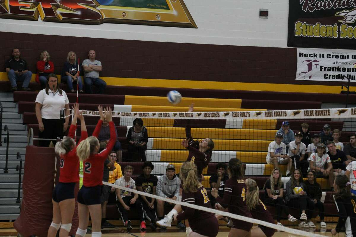Reese's Ashlyn Wolschleger goes for a kill, as USA's Kennedy Schember and Carly Koch go in for the block.
