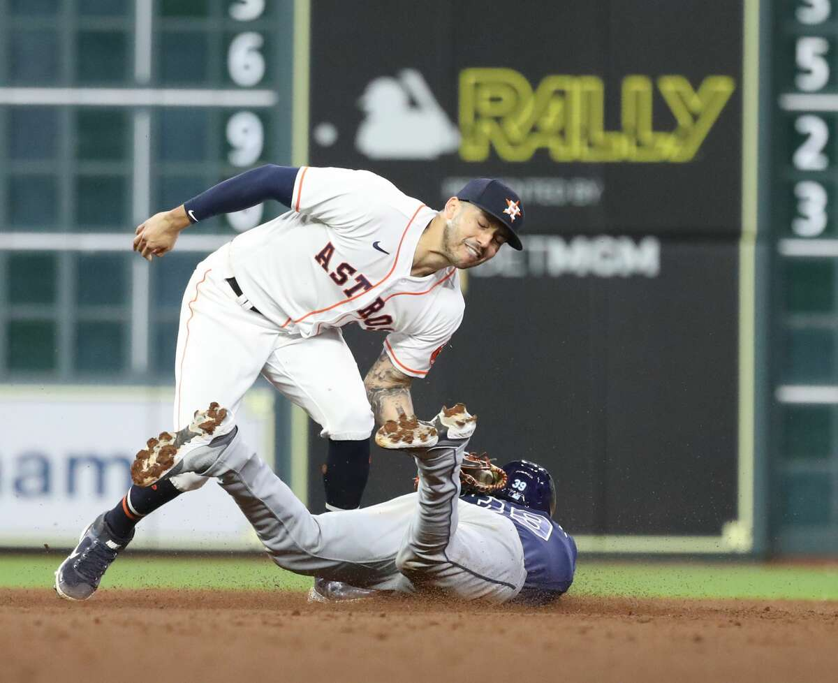 Houston Astros shortstop Carlos Correa (1) catches Tampa Bay Rays Kevin Kiermaier stealing second base as Brandon Lowe struck out to end the top of the eighth inning of an MLB baseball game at Minute Maid Park, Thursday, September 30, 2021, in Houston.