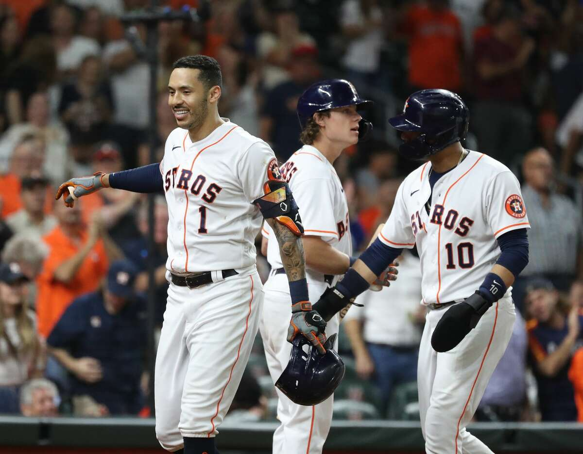 Houston Astros Carlos Correa (1) celebrates his home run off of Tampa Bay Rays relief pitcher Ryan Yarbrough (48) during the fourth inning of an MLB baseball game at Minute Maid Park, Thursday, September 30, 2021, in Houston.