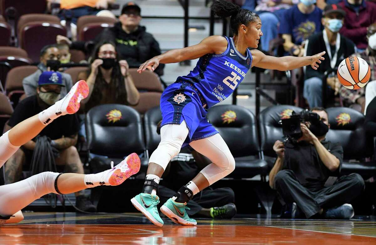 Connecticut Sun forward Alyssa Thomas (25) saves the ball from going out of bounds after stealing it from Chicago Sky center Stefanie Dolson, left, during a WNBA playoff basketball game Thursday, Sept. 30, 2021 at Mohegan Sun Arena in Uncasville, Conn. (Sean D. Elliot/The Day via AP)