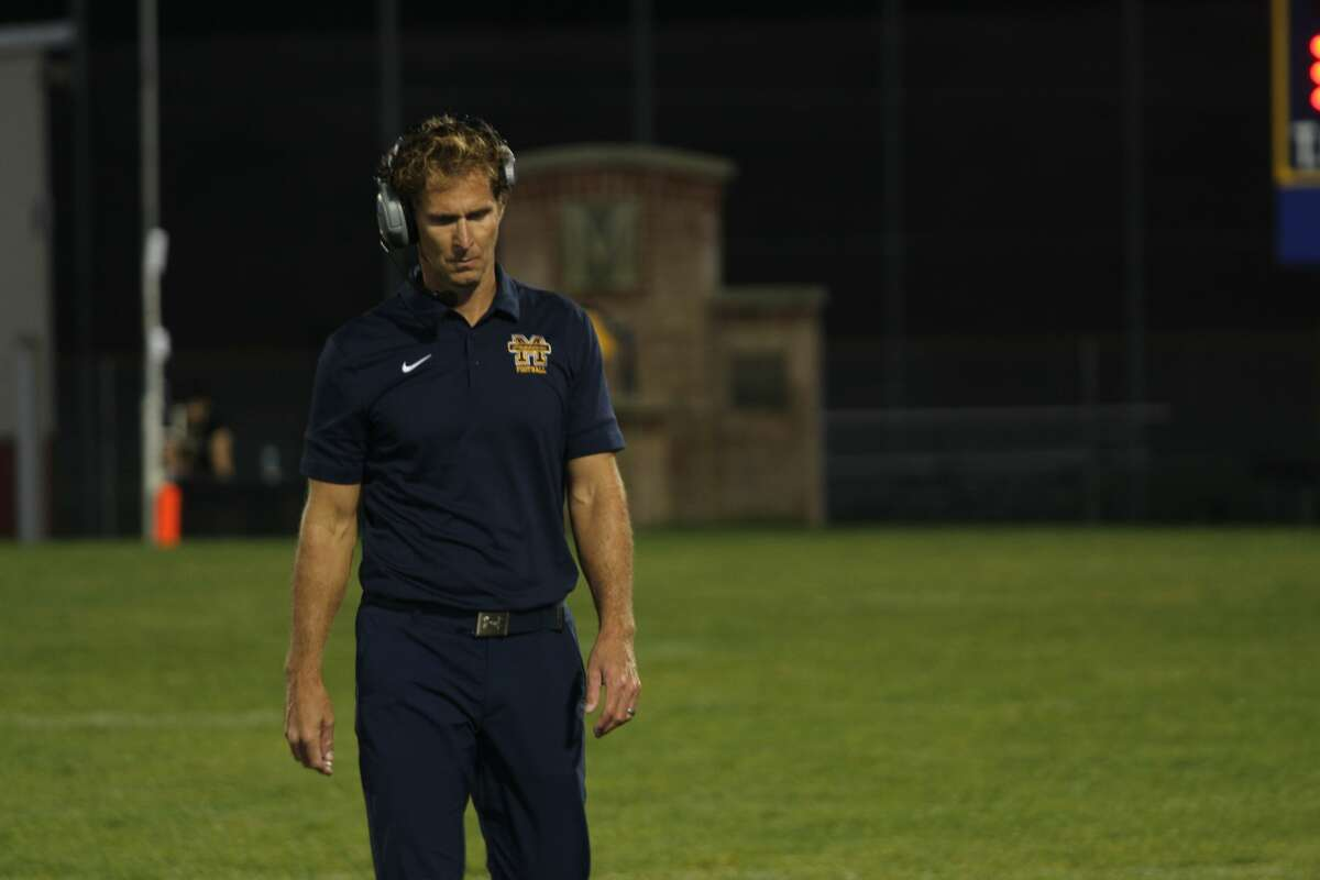 Manistee head coach Troy Bytwork walks down the sidelines during Thursday night's game against Mason County Central.
