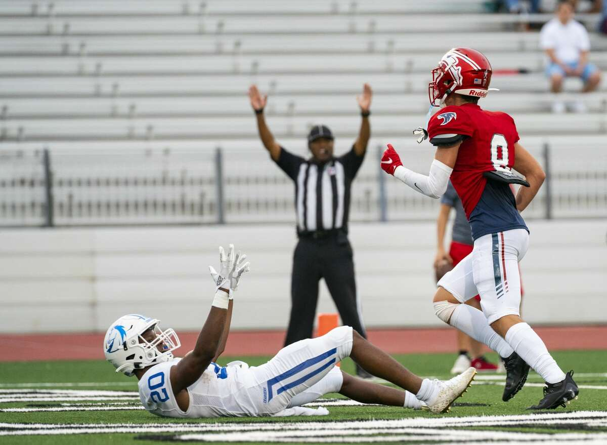 Clear Springs running back Xai-Shaun Edwards celebrates after diving into the end zone and scoring a touchdown during the first half of a 24-6A district game between Clear Springs High School and Clear Lake High School on Thursday, Sept. 30, 2021, at Challenger Columbia Stadium in Houston.