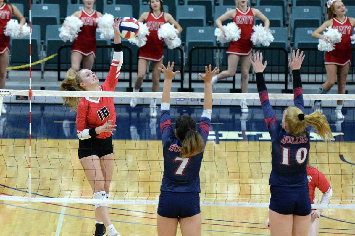 Maddie Waak (16) of Katy tries to hit a shot past Renata Bolado Corona (7) and Kylie Mueller (10) of Dulles during the second set of a Class 6A Region III bi-district volleyball playoff match between the Dulles Vikings and the Katy Tigers on Monday, November 4, 2019 at the Leonard Merrell Center, Katy, TX.