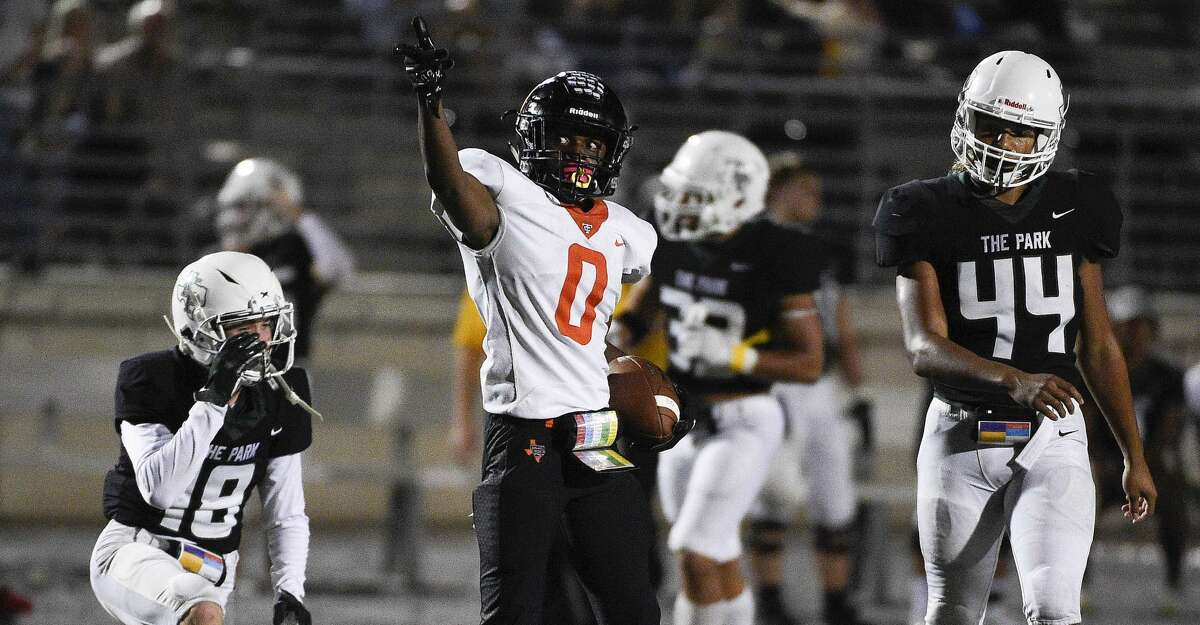 Texas City wide receiver Donovin Carraway (0) signals first down after his reception during the second half of a high school football game against Kingwood Park, Thursday, Sept. 30, 2021, in Humble.