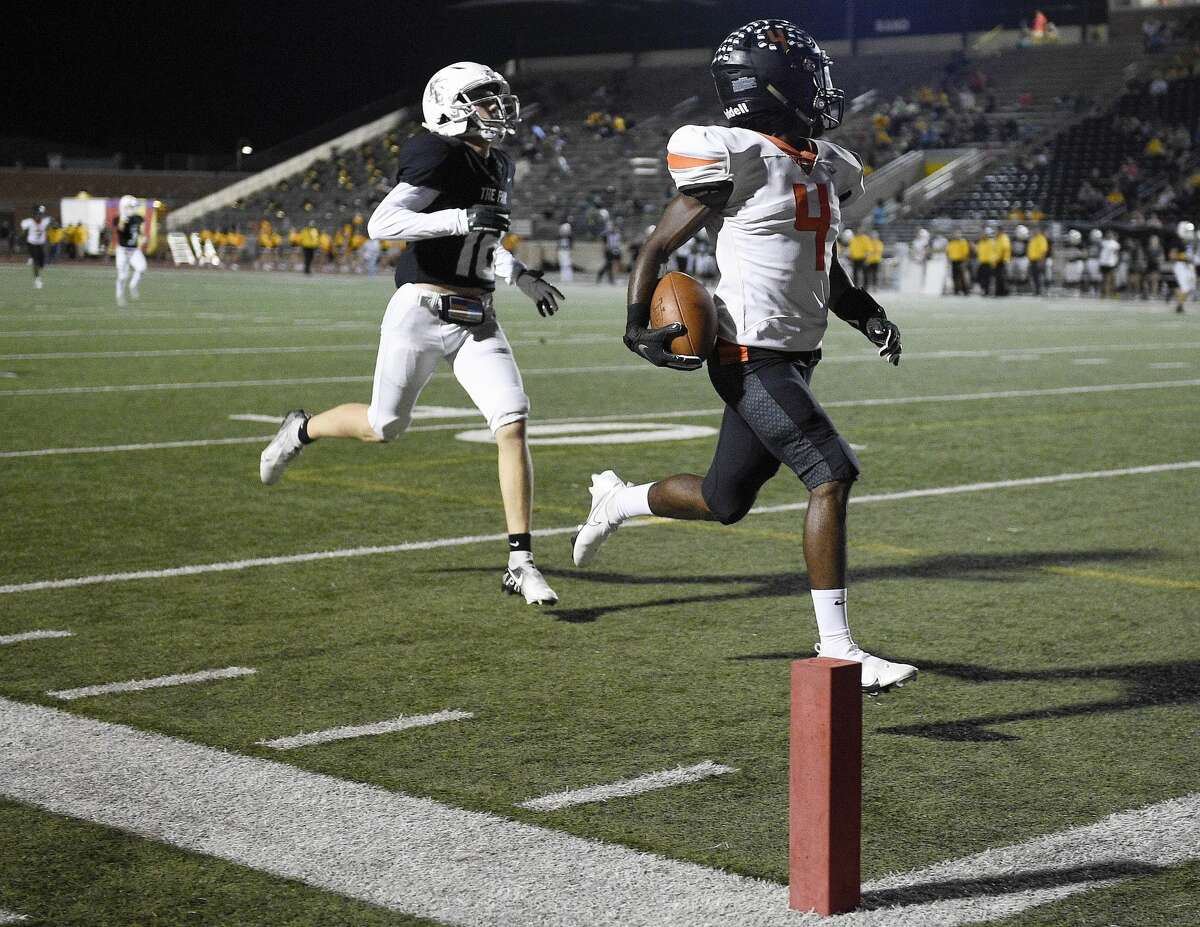 Texas City wide receiver Donovan Avery, right, runs his reception for a touchdown as Kingwood Park defensive back Jaxson Lindsey defends during the first half of a high school football game, Thursday, Sept. 30, 2021, in Humble.