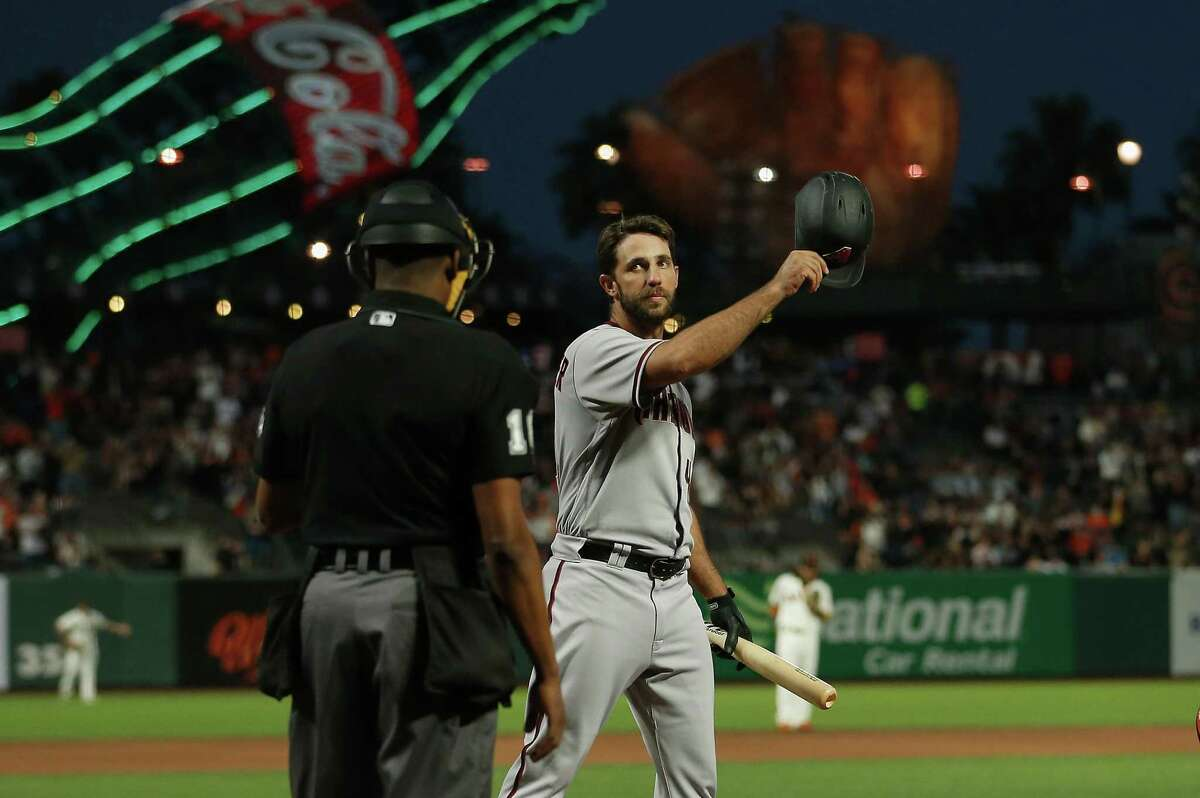 SAN FRANCISCO, CALIFORNIA - SEPTEMBER 30: Former San Francisco Giants player Madison Bumgarner #40 of the Arizona Diamondbacks acknowledges the fans before batting in the top of the first inning against the San Francisco Giants at Oracle Park on September 30, 2021 in San Francisco, California. (Photo by Lachlan Cunningham/Getty Images)
