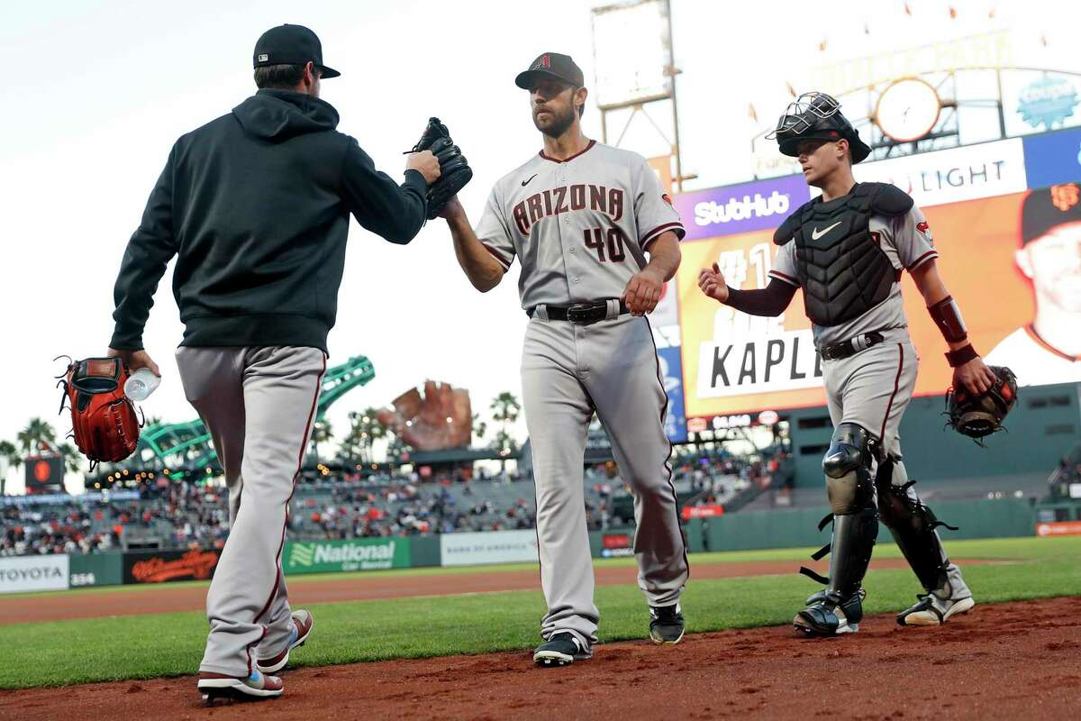 Arizona Diamondbacks' Madison Bumgarner heads to the dugout before his start against San Francisco Giants in MLB game at Oracle Park in San Francisco, Calif., on Thursday, September 30, 2021.