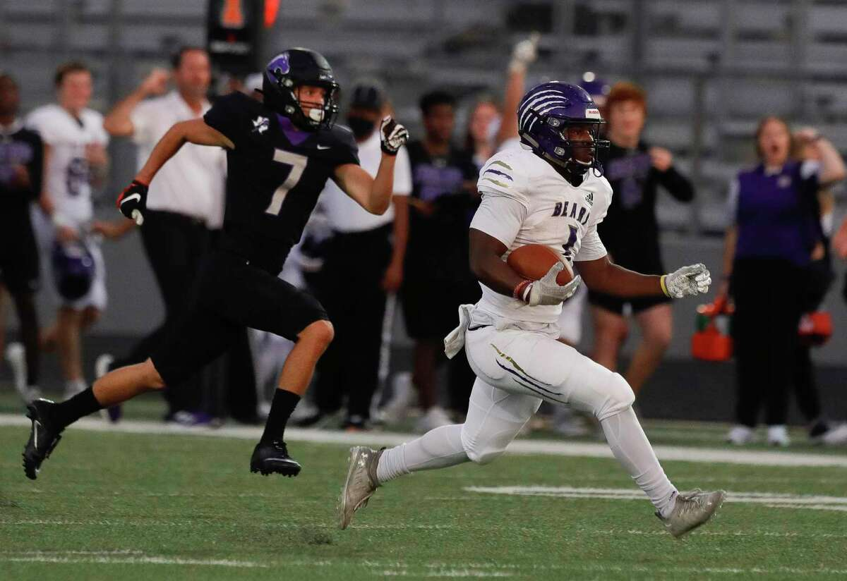 Montgomery running back Jalen Washington (1) runs for a 66-yard touchdown during the first quarter of a high school football game at Traylor Stadium, Thursday, Sept. 30, 2021, in Rosenberg.