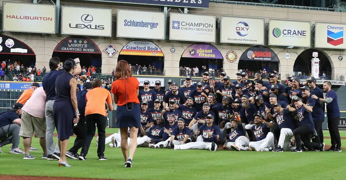 Houston Astros players take a group photo after Houston clinched the AL West with their 3-2 win over Tampa Bay Rays after an MLB baseball game at Minute Maid Park, Thursday, September 30, 2021, in Houston.