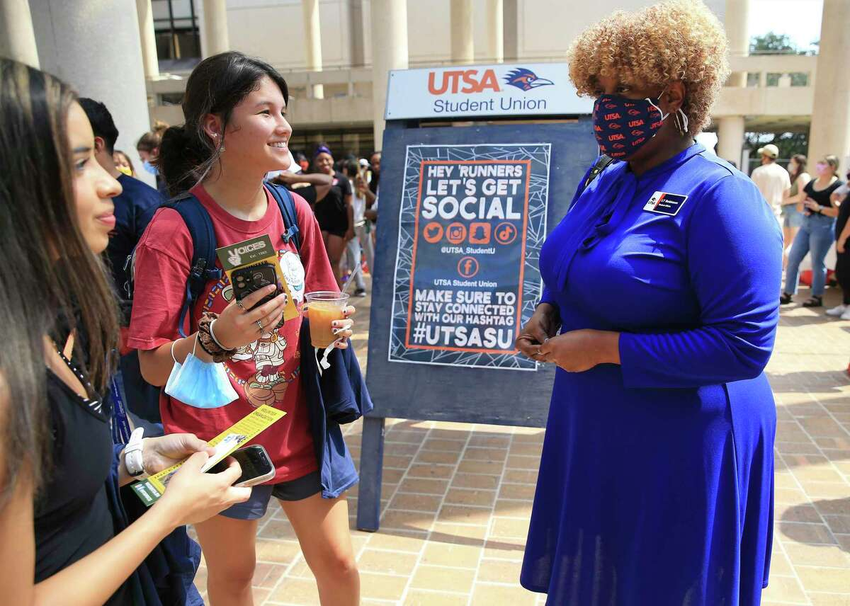 """LaTonya Robinson talks with some of the students at UTSA. """"When our students want to engage our university leadership, more often than not they turn to L.T. as the first place they go,"""" UTSA President Taylor Eighmy says. """"She has one of the most complex jobs on campus ... but one of the least understood."""""""