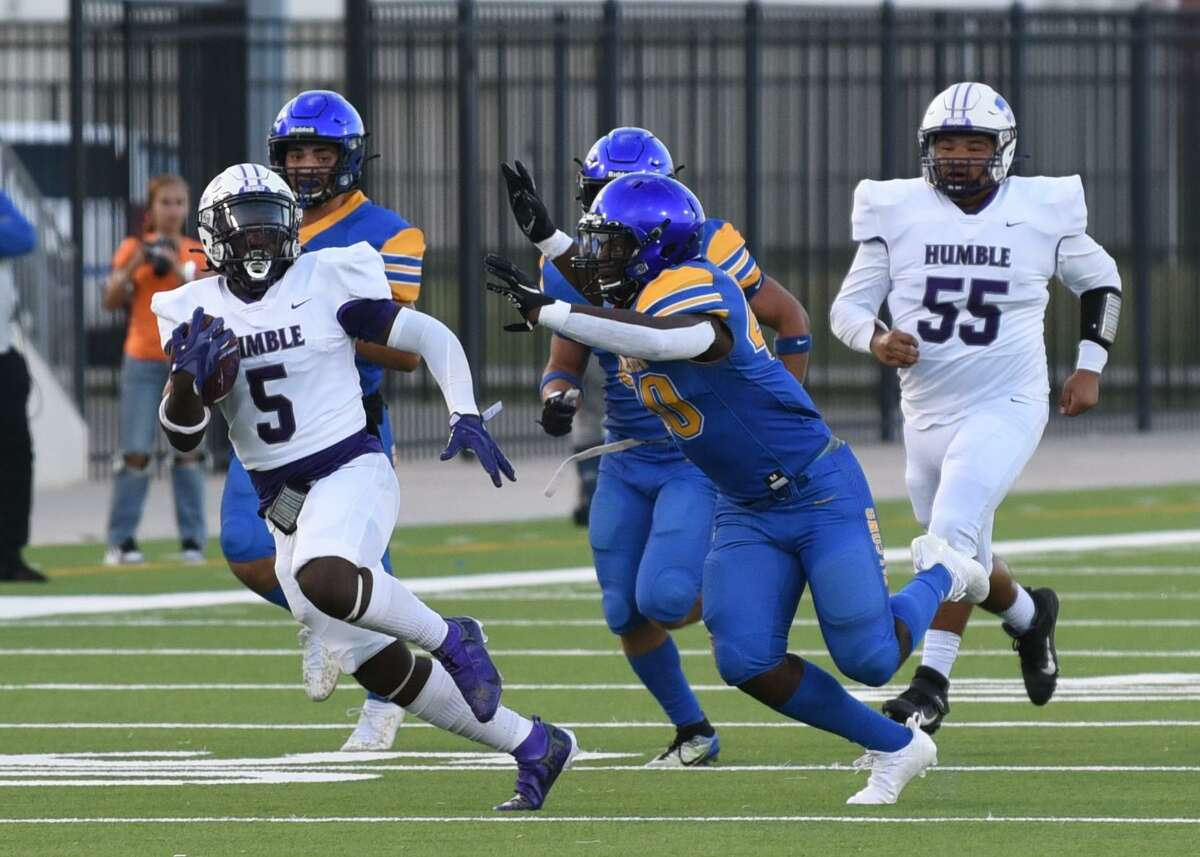 Humble senior running back X'Zavier Sydney evades a Channelview defender during the Wildcats' season opener.