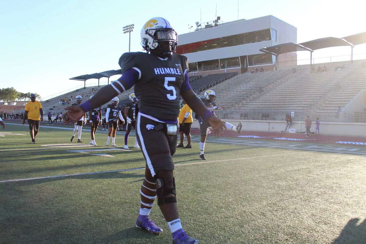 Humble running back X'Zavier Sidney prepares to warmup againt Atascocita in the District 21-6A opener at Turner Stadium.