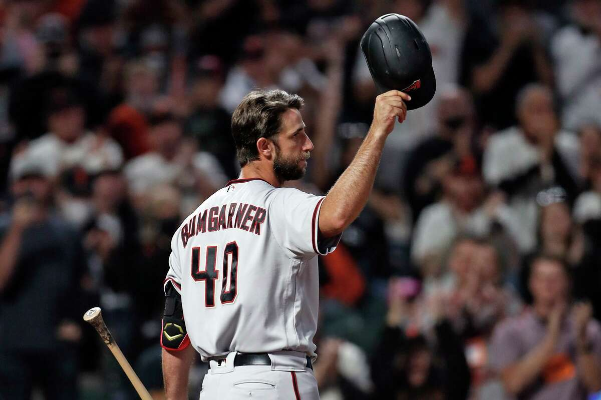 Arizona Diamondbacks' Madison Bumgarner acknowledges the cheers of the San Francisco Giants' fans before batting in 1st inning during MLB game at Oracle Park in San Francisco, Calif., on Thursday, September 30, 2021.