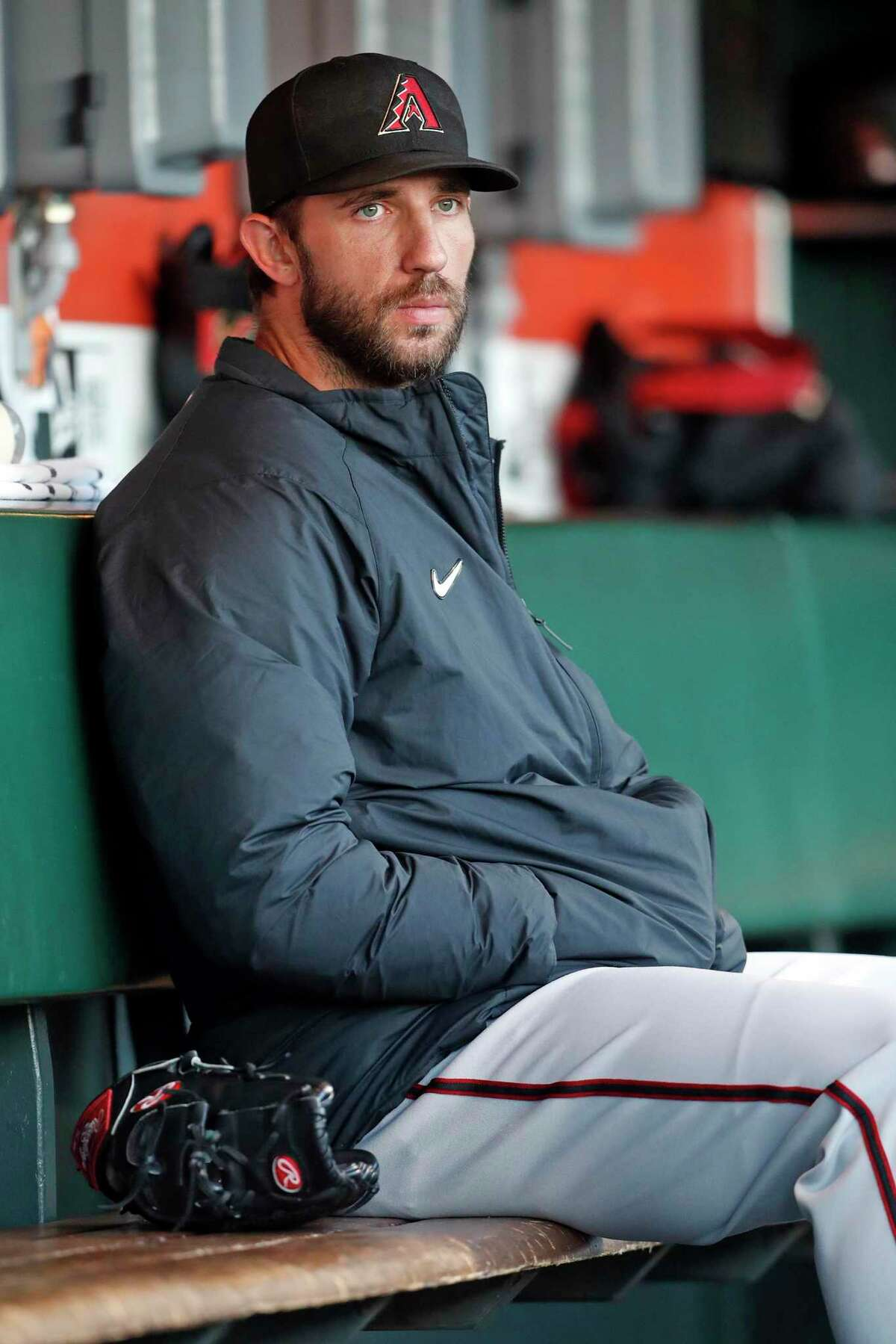 Arizona Diamondbacks' Madison Bumgarner sits in the dugout before warming up for his start against San Francisco Giants in MLB game at Oracle Park in San Francisco, Calif., on Thursday, September 30, 2021.