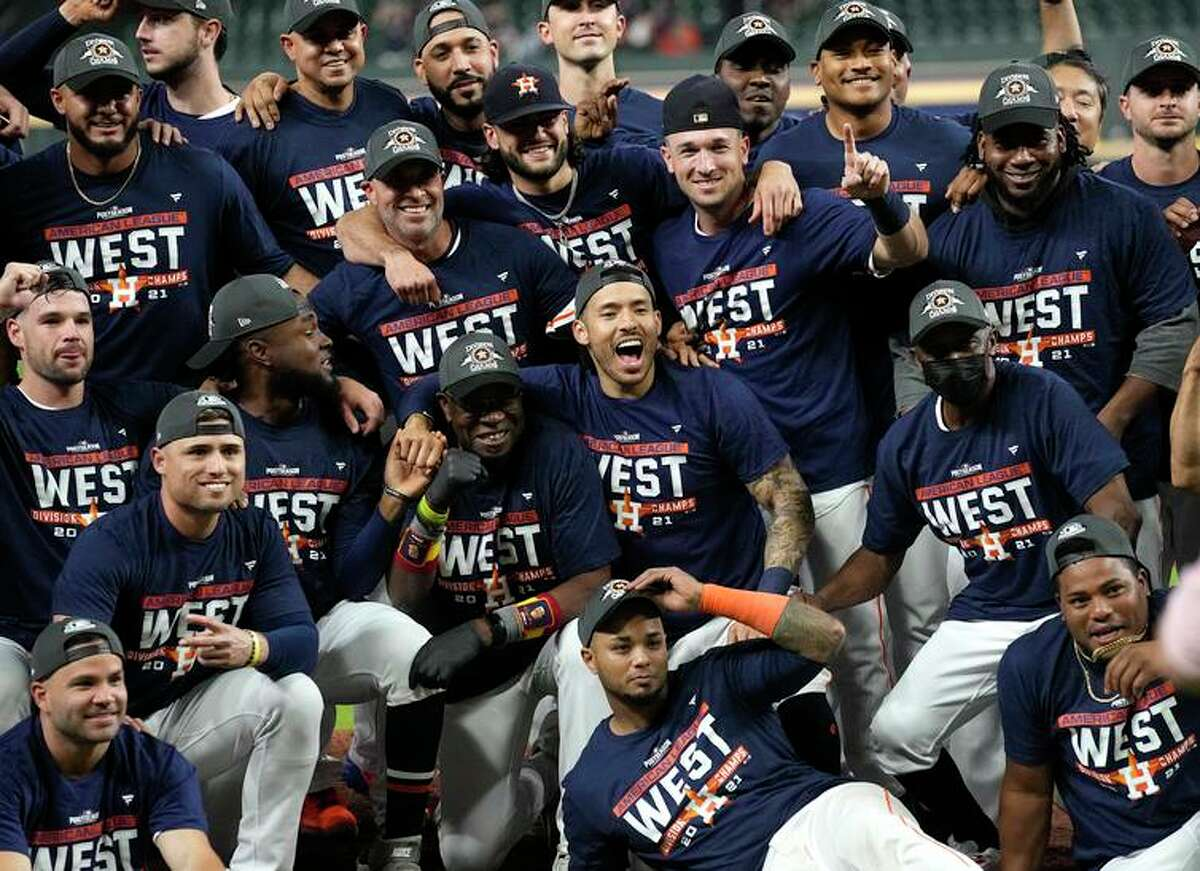 The Astros celebrate after beating the Rays to win the AL West for the fourth time in five years.
