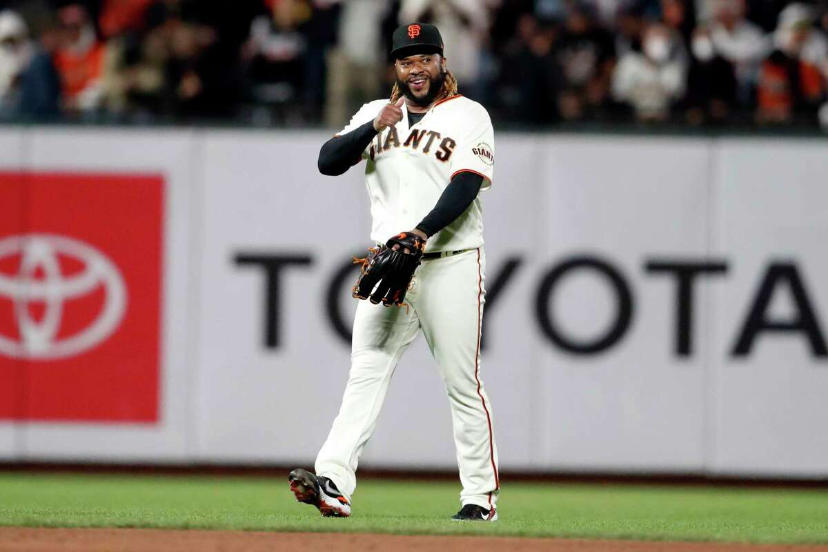 San Francisco Giants' Johnny Cueto smiles as he comes in as a relief pitcher in 3rd inning against Arizona Diamondbacks during MLB game at Oracle Park in San Francisco, Calif., on Thursday, September 30, 2021.