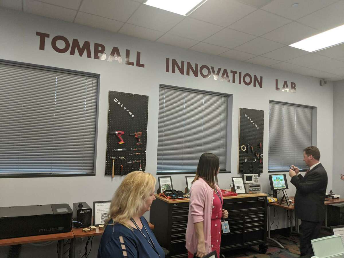 Officials, residents and students attend the grand opening of Lone Star College-Tomball Library's innovation lab. The lab offers the community new equipment and technology including virtual reality, 3D printers, soldering and laser cutting.