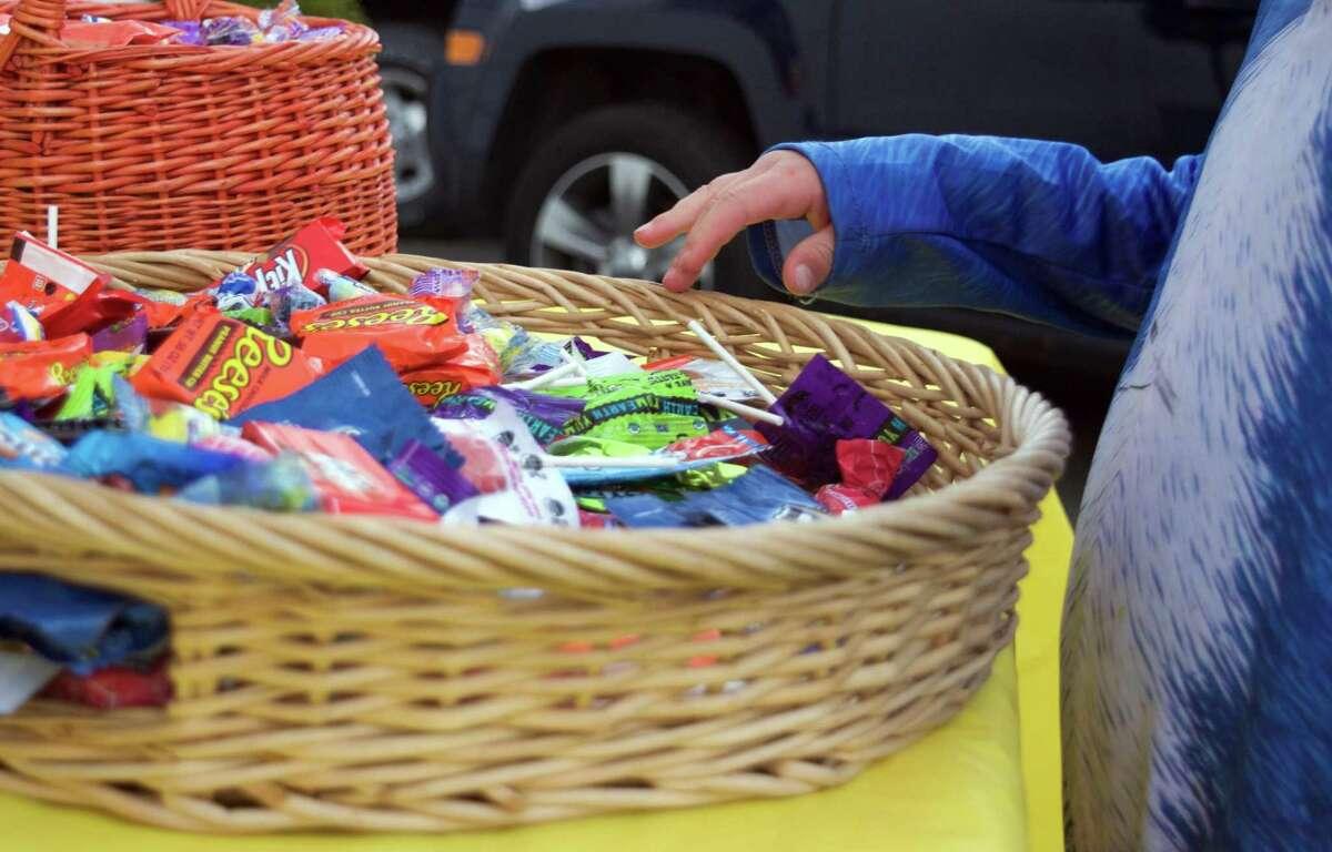 Children grab Halloween candy on Oct. 31, 2020.
