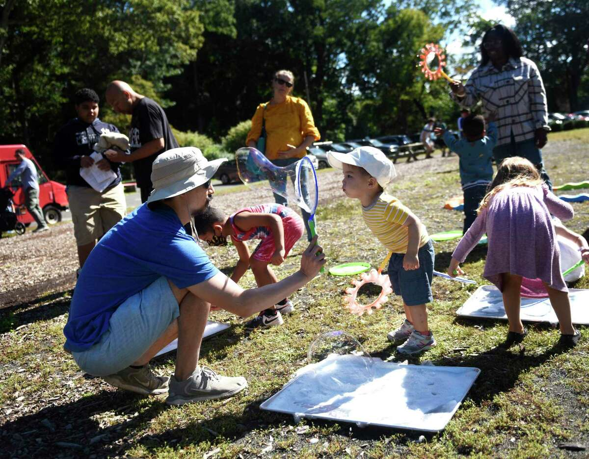 Norwalk's Nathan Li and his son, Ray Li, 2, blow bubbles at the first of three Fall Family Fest Sundays at the Stamford Museum & Nature Center in Stamford, Conn. Sunday, Sept. 26, 2021.