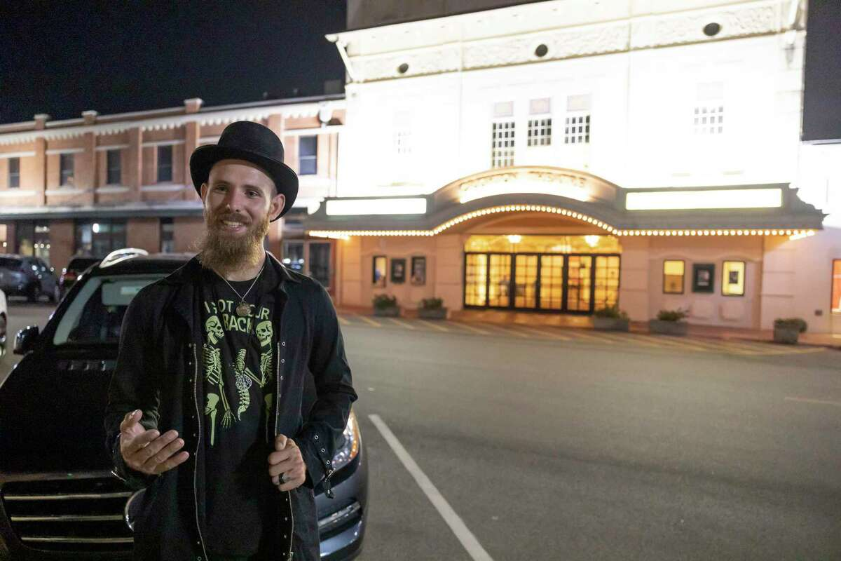 Mathew Whitmire describes the history of the Creighton Theater during the Haunted Conroe Ghost Tour, Saturday, Sept. 25, 2021, in Conroe. The tour is a hour-long paid guide of supposed haunts in downtown Conroe.