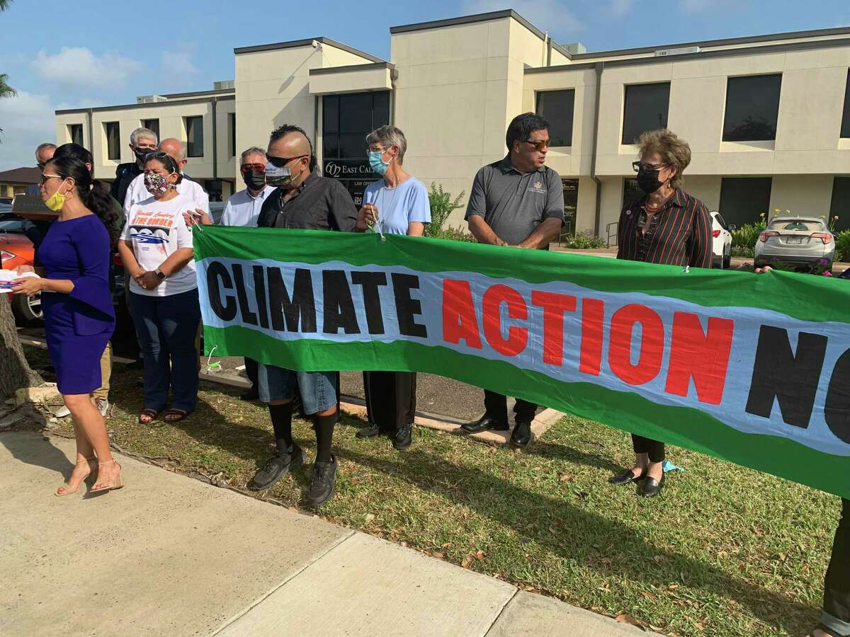 The RGISC and community members gathered outside Rep. Henry Cuellar's Laredo office Thursday asking the congressman to support the Building Back Better Act.
