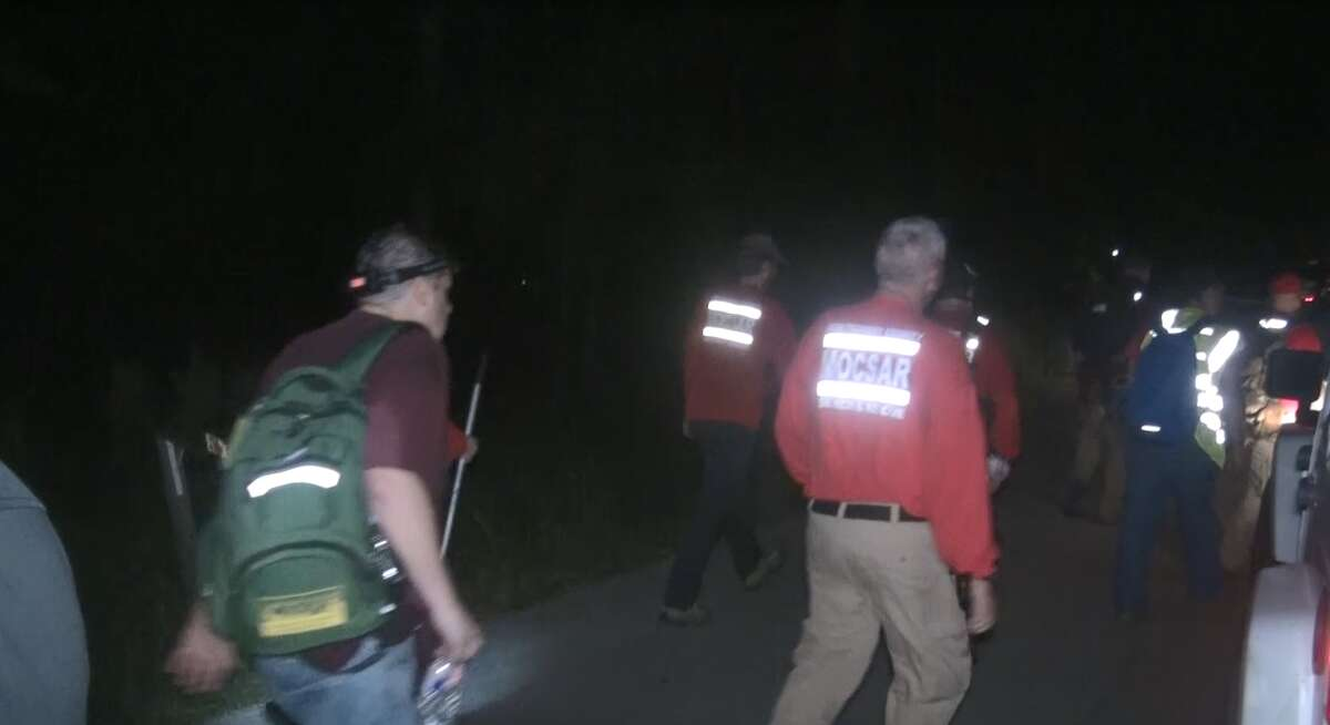 Search and rescue workers look for three missing children who went missing Sept. 30, 2021, in Sam Houston National Forest.