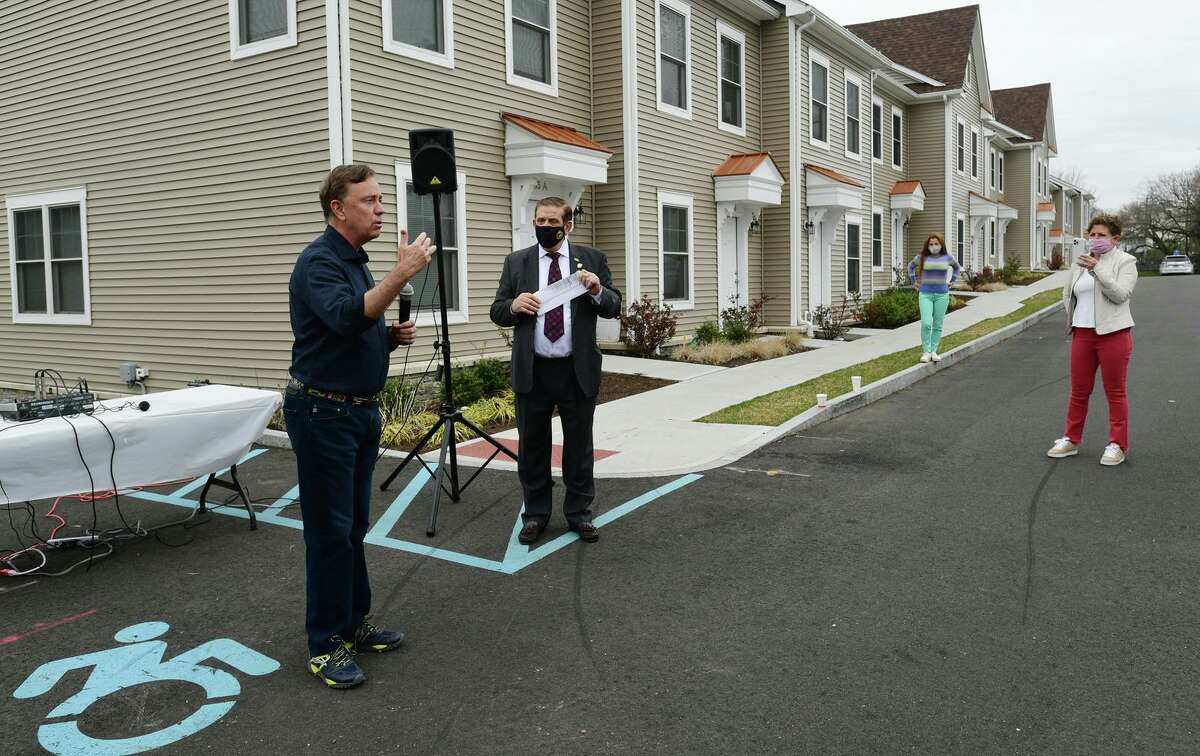 Gov. Ned Lamont speaks at a Greenwich Communities plaque dedication at its Armstrong Court affordable housing apartment complex on April 10, 2021, in Greenwich, Conn.