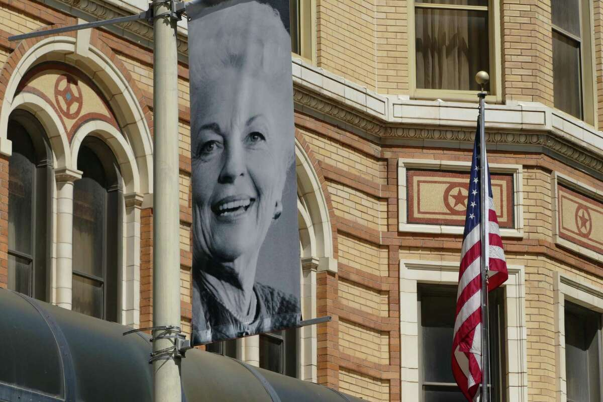 A banner celebrating 30 years since the inauguration of Ann Richards as governor of Texas hangs Wednesday over St. Mary's at Houston Street in downtown San Antonio.