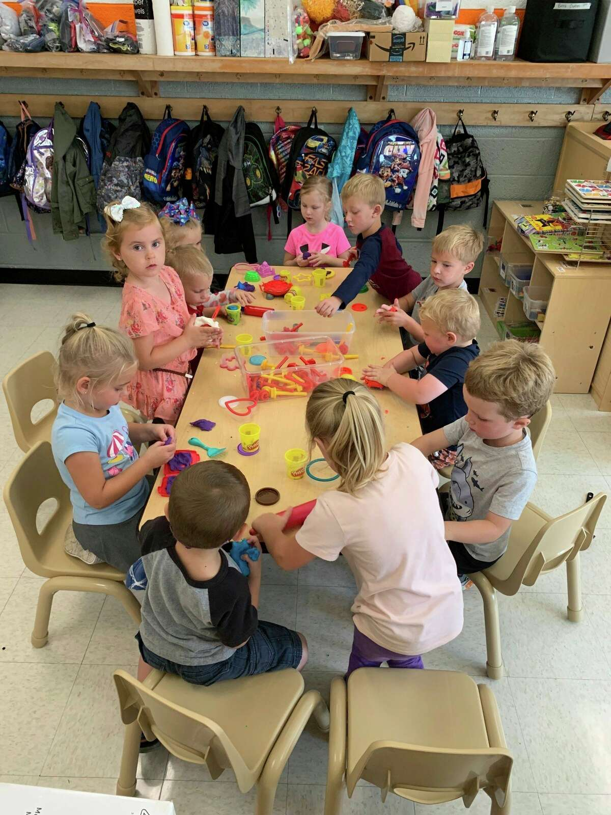 Ubly Preschool children are playing with playdough and working on sharing and using their words to ask for items they want.(Ubly Preschool/Courtesy Photo)