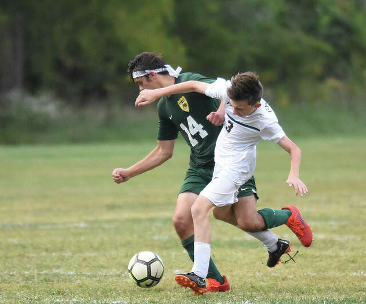 Father McGivney's Alec Forhnert, right, battles with Metro-East Lutheran's Collin Jose for possession of the ball late in the second half on Thursday in Edwardsville.