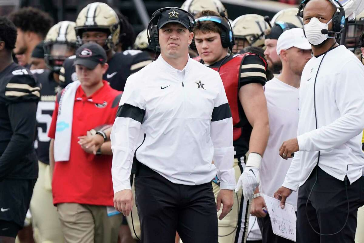 Vanderbilt head coach Clark Lea, center, watches from the sideline in the first half of a 62-0 loss to Georgia Saturday. Vanderbilt hosts UConn Saturday night.