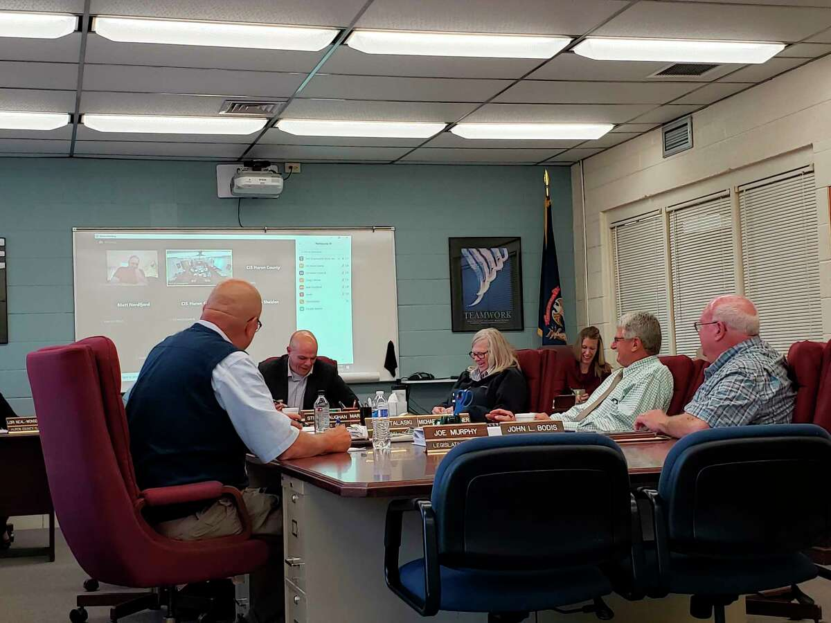The Huron County Board of Commissioners chat during their meeting on Thursday, where they passed a resolution stating the county would not require any vaccines for its employees. (Robert Creenan/Huron Daily Tribune)