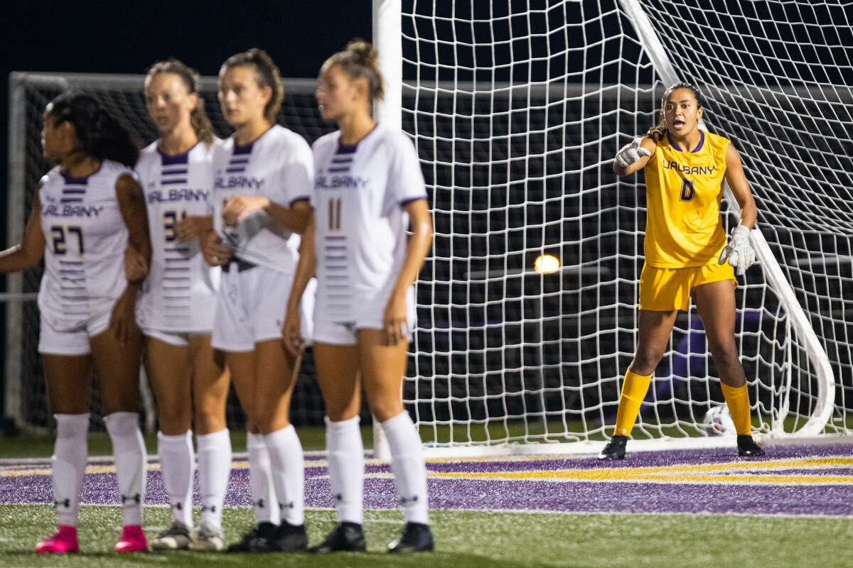 The UAlbany women's soccer team plays a Pride game Sunday, Oct. 3, 2021, celebrating the LGBTQ community and continuing to help support and raise the voice of one of its captains, goalie Sophia Chen, right.