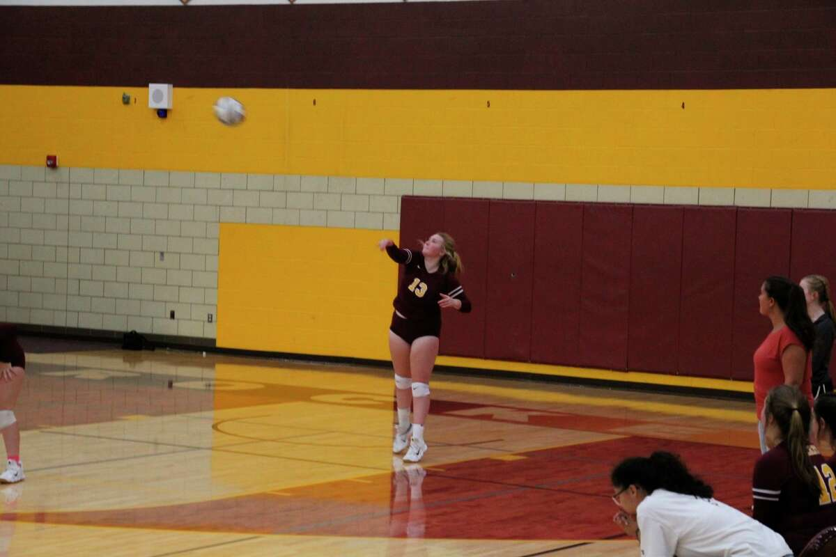 Reese's Andi Reinert delivers a serve during the Lady Rockets' run in the second set.