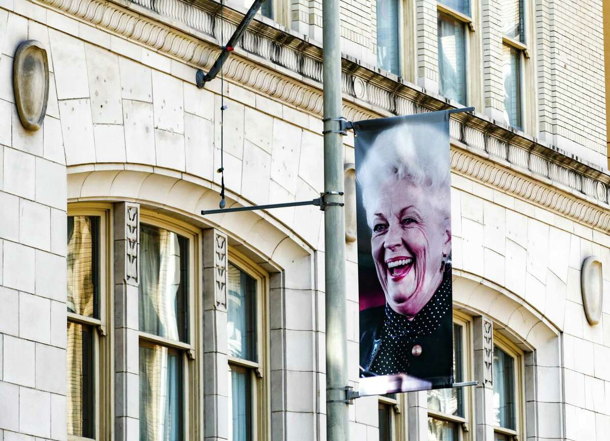 A banner celebrating 30 years since the inauguration of Ann Richards as governor of Texas hangs Wednesday over St. Mary's Street in downtown San Antonio.