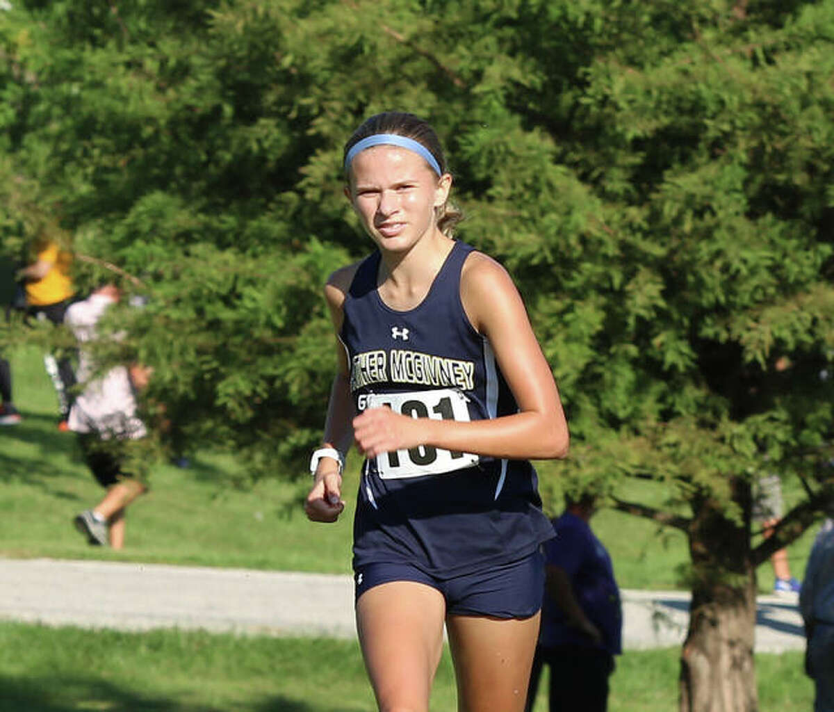 In this file photo, Father McGivney freshman Elena Rybak is shown nearing the finish in her win at the Highland Invite.