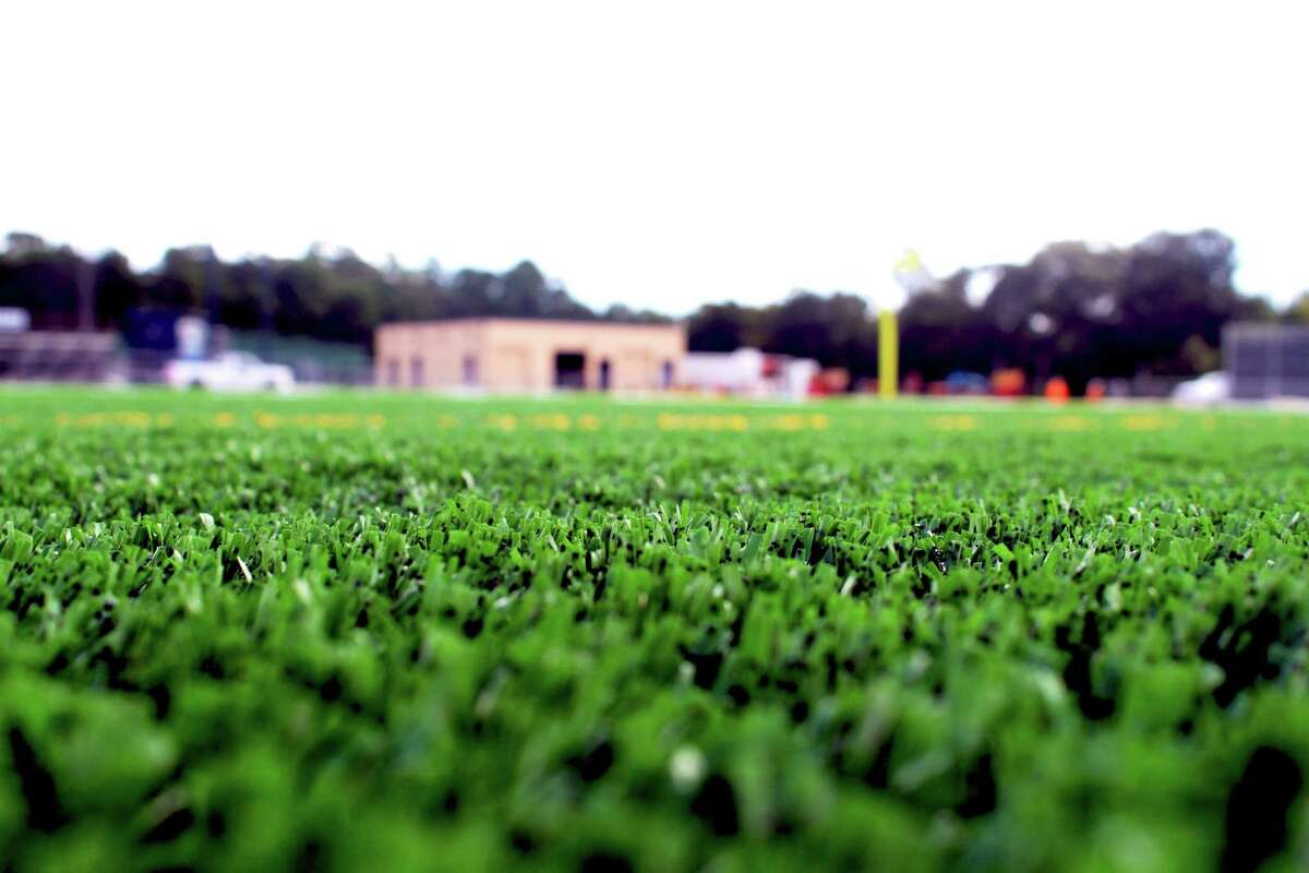 A synthetic field turf at a high school football field.
