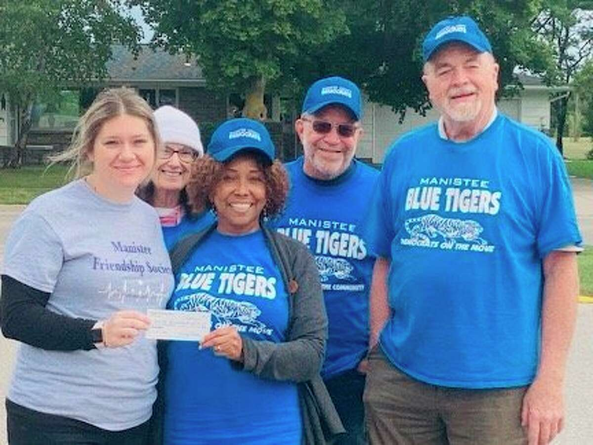(From left) Shown are Cassandra Kamaloski, executive director of Friendship Society; Pat Lampinen, Shirley Madden, chairperson for the Blue Tigers; Eric Lampinen, Gary Madden. (Courtesy photo)