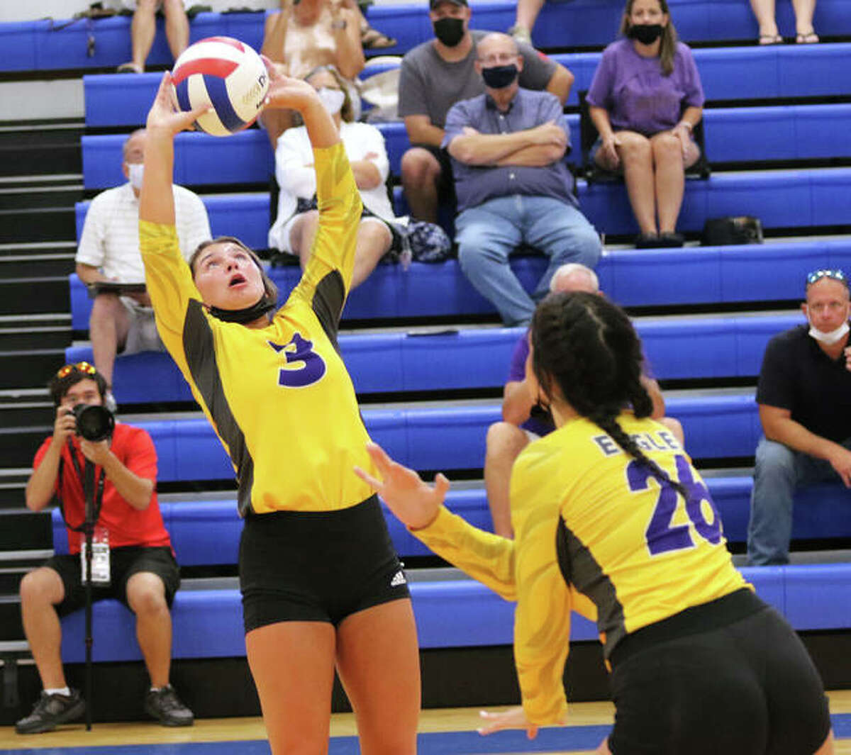 CM's Maddie Brueckner (3) sets as teammate Camryn Gehrs heads to the net in an August match at the Roxana Tourney. On Thursday, Brueckner had a double-double with 23 assists and 10 digs in the Eagles' three-set MVC loss at Highland.