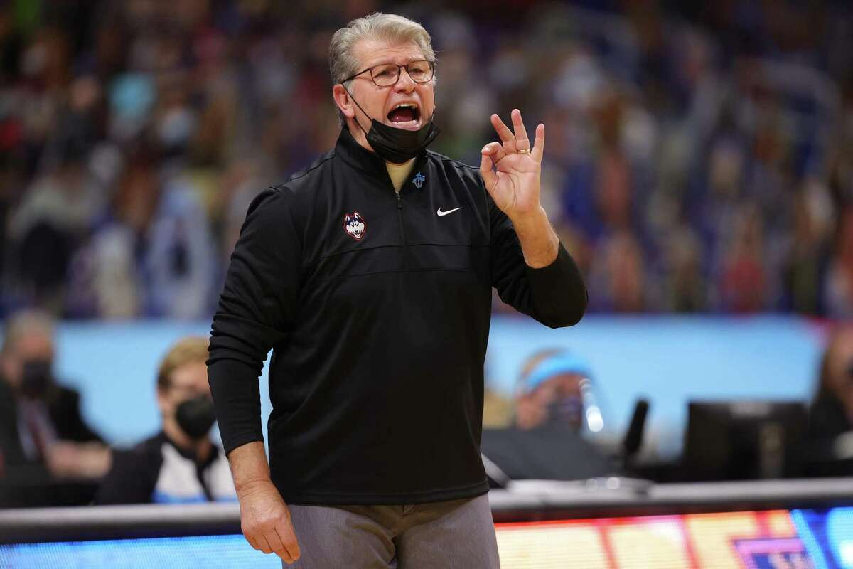 SAN ANTONIO, TEXAS - APRIL 02: Head coach Geno Auriemma of the UConn Huskies calls out to players against the Arizona Wildcats during the second quarter in the Final Four semifinal game of the 2021 NCAA Women's Basketball Tournament at the Alamodome on April 02, 2021 in San Antonio, Texas. (Photo by Carmen Mandato/Getty Images)
