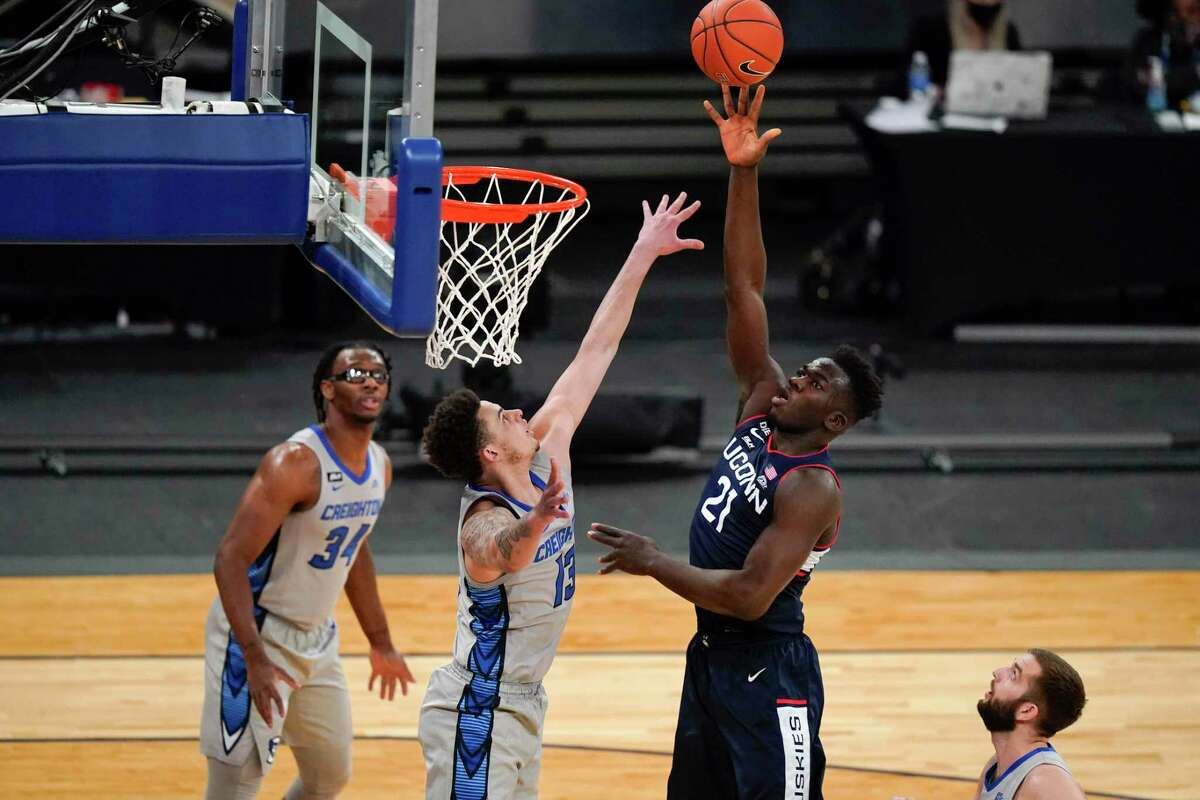UConn's Adama Sanogo, shooting over Creighton's Christian Bishop last season, is expected to be the Huskies' best player this season.