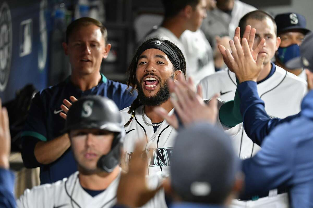 SEATTLE, WASHINGTON - SEPTEMBER 27: J.P. Crawford #3 of the Seattle Mariners celebrates with teammates after Mitch Haniger hit a three-run home run in the fourth inning against the Oakland Athletics at T-Mobile Park on September 27, 2021 in Seattle, Washington. (Photo by Alika Jenner/Getty Images)