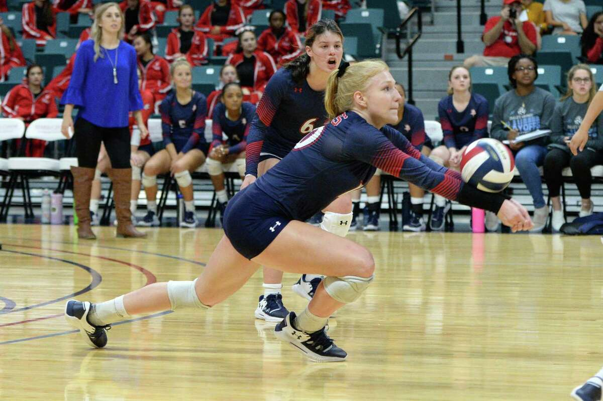 Kylie Mueller (10) of Dulles digs for a ball during the first set of a Class 6A Region III bi-district volleyball playoff match between the Dulles Vikings and the Katy Tigers on Monday, November 4, 2019 at the Leonard Merrell Center, Katy, TX.
